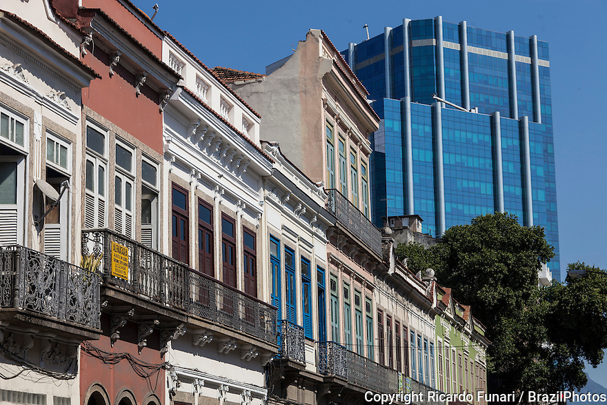 Urban contrast - preserved sobrados, two or more story ancient houses from the colonial and imperial periods in Brazil next to corporate modern building at Rua do Senado ( Senate street ) in downtown Rio de Janeiro, as part of the city corredor cultural ( cultural corridor ).