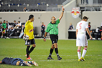 Brandon Adler (5) of the New York Red Bulls is sent off for a foul on Mario Rodriguez (9) of the USA. The USMNT U-17 defeated New York Red Bulls U-18 4-1 during a friendly at Red Bull Arena in Harrison, NJ, on October 09, 2010.