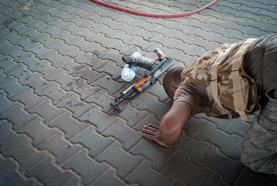 Rebel fighter prays under the bridge in Zawiya, Libya