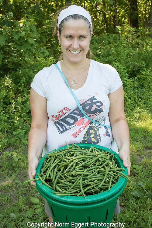 Young woman who has volunteered to work on a non-profit farm that provides food to the Worcester County Food Bank