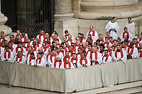 Città del Vaticano, 13 Aprile, 2014. Preti in Piazza San Pietro assistono alla messa delle Palme. Priests attend the Palm Sunday Mass at St. Peter's Square.