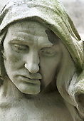 A worn down statue at the base of the memorial...Photo taken 10 May 2000 at the Canadian War Memorial at Vimy, France..Credit: Justin Jin