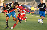 San Jose Earthquakes' James Riley (4) and FC Dallas' Juan Toja (8), battle for the ball. .The San Jose Earthquakes tied FC Dallas 0-0, at Buck Shaw Stadium, in Santa Clara, California, Saturday, May 3, 2008. .