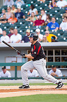 Brad Nelson (30) of the Rochester Red Wings follows through on his swing against the Charlotte Knights at BB&T Ballpark on June 5, 2014 in Charlotte, North Carolina.  The Knights defeated the Red Wings 7-6.  (Brian Westerholt/Four Seam Images)