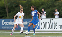 Boston Breakers midfielder Jo Dragotta (25) passes the ball as Western New York Flash forward Adriana Martin (8) closes. In a National Women's Soccer League Elite (NWSL) match, the Boston Breakers (blue) tied Western New York Flash (white), 2-2, at Dilboy Stadium on June 5, 2013.