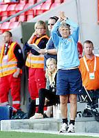 USA coach Pia Sundhage claps her hands. USA 4,  Norway 0, Fredrikstad Stadium, July 2, 2008.
