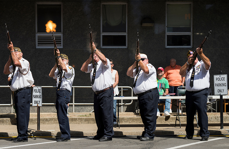 UNITED STATES - JULY 5: Local veterans fire rifles in salute during the presentation of the colors at the West Virginia Freedom Festival in downtown Logan, W. Va., on July 5, 2014. (Photo By Bill Clark/CQ Roll Call)
