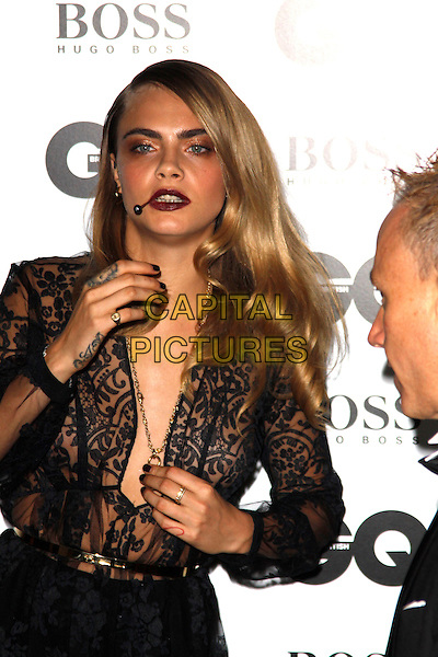 LONDON, ENGLAND - SEPTEMBER 02 :   Cara Delevingne arrives at the GQ Men Of The Year 2014 at The Royal Opera House on September 02, 2014 in London, England.<br /> CAP/AH<br /> &copy;Adam Houghton/Capital Pictures