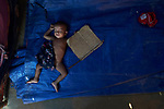 A Rohingya child sleeps in a shelter in the Jamtoli Refugee Camp near Cox's Bazar, Bangladesh. <br /> <br /> More than 600,000 Rohingya refugees have fled government-sanctioned violence in Myanmar for safety in this and other camps in Bangladesh.