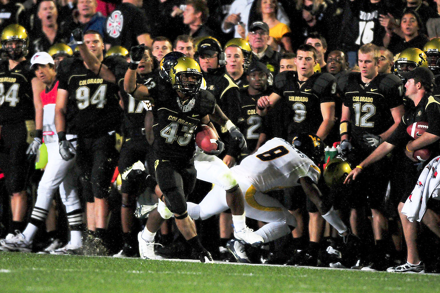 18 September 08: Colorado tailback Rodney Stewart (43) runs along the sideline against West Virginia. The Colorado Buffaloes defeated the West Virginia Mountaineers 17-14 in overtime at Folsom Field in Boulder, Colorado. For Editorial Use Only.