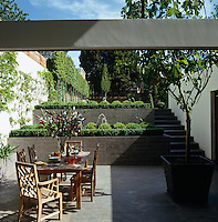The garden is terraced and has a contemporary sunken patio