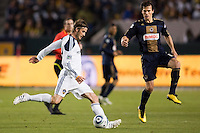 LA Galaxy midfielder David Beckham (23) sends a ball across field. The LA Galaxy defeated the Philadelphia Union 1-0 at Home Depot Center stadium in Carson, California on  April  2, 2011....