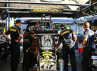 Aug. 3, 2014; Kent, WA, USA; Crew members working on the engine of NHRA top fuel dragster driver Richie Crampton during the Northwest Nationals at Pacific Raceways. Mandatory Credit: Mark J. Rebilas-