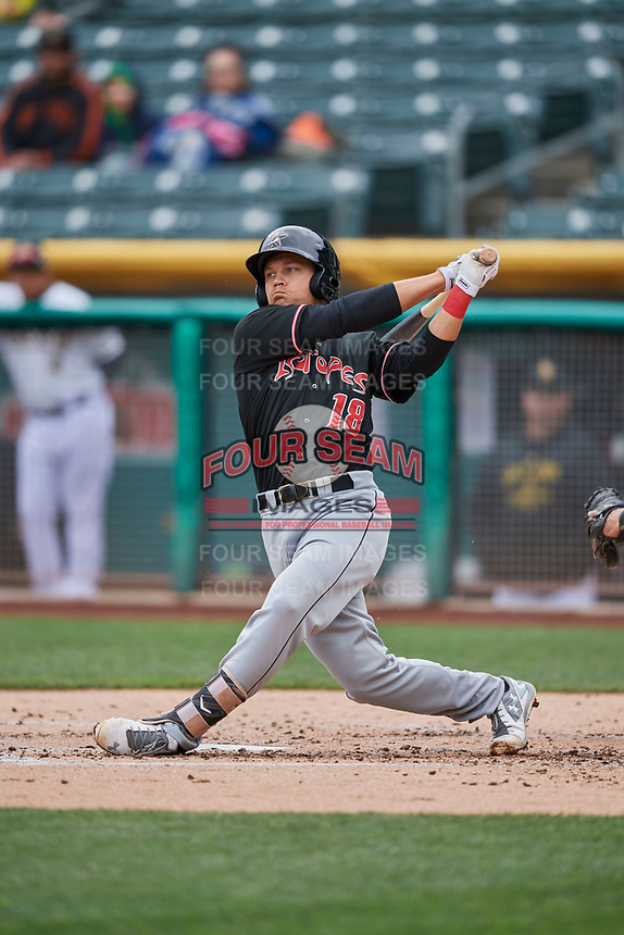 Anthony Phillips (18) of the Albuquerque Isotopes bats against the Salt Lake Bees at Smith's Ballpark on April 8, 2018 in Salt Lake City, Utah. Albuquerque defeated Salt Lake 11-4. (Stephen Smith/Four Seam Images)