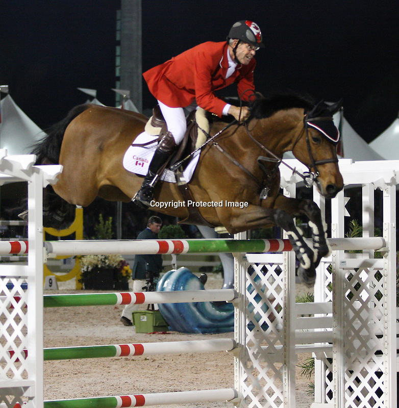 Ian Millar and In Style compete for Canada in the $75,000 FEI Nations Cup, an Olympics-style show jumping event, on Friday night, Feb. 28, 2009, during the Winter Equestrian festival in Wellington, Fla. Canada won the eight-nation, two-round competition before the first sellout (8,000) at the recently-renovated Palm Beach International Equestrian Center. Canada edged Ireland and Great Britain (tie) for the blue ribbons, followed by the United States. Also competing were teams from Argentina, France, Mexico and Venezuela. Thousands of cheering, flag-waving fans packed the International Arena at the WEF grounds for the Nations Cup, reportedly the oldest and most prestigious team show jumping competition in the world. Photo by Bob Markey II