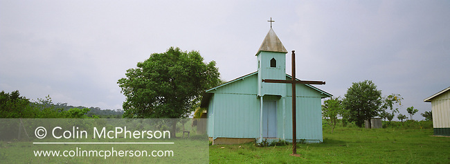 An evangelical Christian church located by the side of Highway BR163, one of many which have sprung up along the highway as the population changes due to changing agricultural practices in the area. The highway ran from Santarem on the banks of the Tapajos river for one thousand miles south into the state of Mato Grosso and was unpaved except for a small stretch at its northern end. The area surrounding the highway was the front line in the battle between local communities and environmentalists who tried to prevent to spread of rainforest destruction by illegal loggers and companies which bought and seized land for use in cattle ranching and growing soy beans for export from Brazil via the port at Santarem.