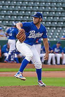 Ogden Raptors starting pitcher Jairo Pacheco (11) delivers a pitch to the plate against the Idaho Falls Chukars in Pioneer League action at Lindquist Field on August 26, 2015 in Ogden, Utah. Ogden defeated the Chukars 5-1. (Stephen Smith/Four Seam Images)
