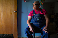 Grant looks out the doorway of his trailer. In Sneadville, Tennessee, the median annual income for elderly is $11,000. Food assistance is an enormous help to folks like Grant and Barbara Gibson, who also care for their inlaws.