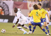 Jozy Altidore #17 of the USA breaks away from David Luiz #4 and Paulo Henrique Ganso #10 of Brazil during an international friendly matchl in Giants Stadium, on August 10 2010, in East Rutherford, New Jersey.Brazil won 2-0.