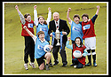24/02/2009  Copyright Pic: James Stewart.File Name : sct_jspa07_scottis_cup.FORMER FALKIRK LEGEND ALEX TOTTEN SHOWS OFF THE HOMECOMING SCOTLAND SCOTTISH CUP TO (l to r rear) REBECCCA LEWIS, SARAH JOHNSTON, IAN MCARTHUR, ROSS ANDERSON (l to r front) STUART IRVINE AND CAITLIN MUNGALL, PRIMARY SEVEN PUPILS AT ST MARGARET'S PRIMARY SCHOOL, POLMONT......Press Release..... A unique interactive tour to engage primary school children with football and the Homecoming Scottish Cup rolls into town today, Tuesday 24 February 2009 at St Margaret's Primary School in Falkirk.  . .Up to 100 pupils in primaries 5 to 7 at each local school will receive specialist skills and drill training from Scottish Football Association coaches as well as getting the chance to view the Homecoming Scottish Cup trophy itself.. .The school tour takes the form of a giant 'football-shaped' tent, which houses the world's oldest footballing trophy and information about Homecoming Scotland and the Scottish Cup tournament.. .Future football stars will be given soccer skills training ahead of watching their home team, Falkirk, take on Inverness Caledonian Thistle in the quarter finals of the Homecoming Scottish Cup on the weekend of 7 March.. .Falkirk legend Alex Totten, who used to manage the side, will be on hand at St Margaret's Primary School to share his knowledge and experience with the kids and to see the trophy himself.. .All primary schools in Scotland will also be sent education packs to encourage pupils to know more about Homecoming Scotland and to learn more about healthy eating, fitness and playing football as a way to keep fit and have fun.  . .As part of the football celebrations, the tour will then encourage locals in the town centre to get behind their local team, when the cup visits The Mall in Falkirk later in the afternoon.. .The Homecoming Scottish Cup Tour has been designed to engage with Scotland's local communities and spread the message about joining in the celebrations for Homecomi