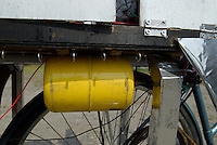 An air cylinder for a truck horn fixed to a decochari.