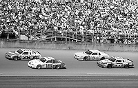 Cale Yarborough Ricky Rudd Geoff Bodinr Harry Gant action Daytona 500 at Daytona International Speedway in Daytona Beach, FL in February 1985. (Photo by Brian Cleary/www.bcpix.com) Daytona 500, Daytona International Speedway, Daytona Beach, FL, February 1985. (Photo by Brian Cleary/www.bcpix.com)