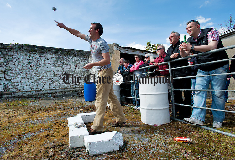 Jason Coyle of Drinagh, Inagh, in action at the World Stone Throwing Championships in Corofin. Photograph by John Kelly.