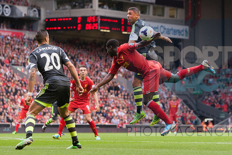Stoke's Jon Walters beats Kolo Toure of Liverpool in the air - Liverpool vs. Stoke City -  Premier League - Anfield - Liverpool - 17/08/2013 Pic Philip Oldham/Sportimage