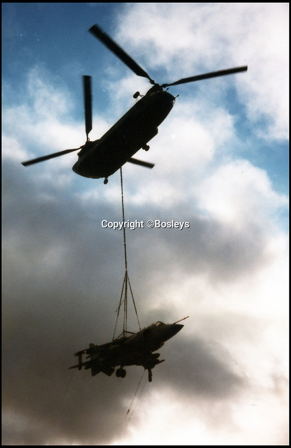 BNPS.co.uk (01202 558833)Pic: Bosleys/BNPS<br /> <br /> Chinook loading a Sea Harrier.<br /> <br /> Never-before-seen photos have emerged to show the hilarious moment Prince Andrew was mercilessly ridiculed as part of a Royal Naval initiation 36 years ago.<br /> <br /> The young officer was made to take part in a Crossing the Line ceremony to mark the first time he passed the equator as a seaman.<br /> <br /> In a nod to Prince Andrew's Royal background, the photos show him sat on makeshift throne with a cardboard crown placed on his head.<br /> <br /> Alarmingly, a seaman dressed as the barber is seen approaching the then second-in-line to the throne with a very large meat clever covered in imitation blood.