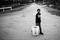 Jamarcus Wilson walks home along the dirt roads of Hog Hammock on Sapelo Island after trying to catch some shrimp and fish with his cast net.
