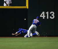 Kyle Schwarber (right)  collided with Dexter Fowler (left) of the Chicago Cubs attempting to make a catch of a flyball by Jean Segura of the Arizona Diamondbacks in the second inning of a game at Chase Field on April 7, 2016 in Phoenix, Arizona. Segura circled the bases for an inside-the-park homerun. Schwarber had to be removed from the game and is awaiting the results of an MRI  (Bill Mitchell)