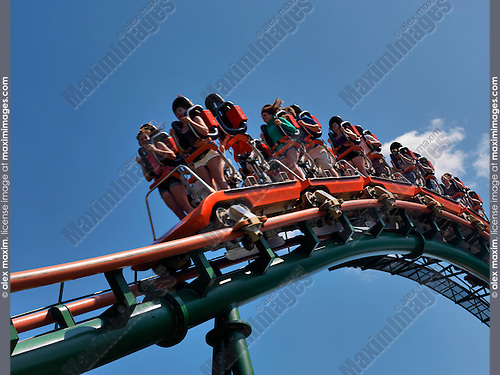 People on a Roller coaster ride at Canada's Wonderland amusement park. Vaughan Ontario Canada.