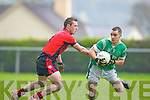 John O'Connor Milltown/Castlemaine turns Francis O'Reilly Clondegad in the quarter final of the Munster Intermediate Club championship at Milltown on Sunday
