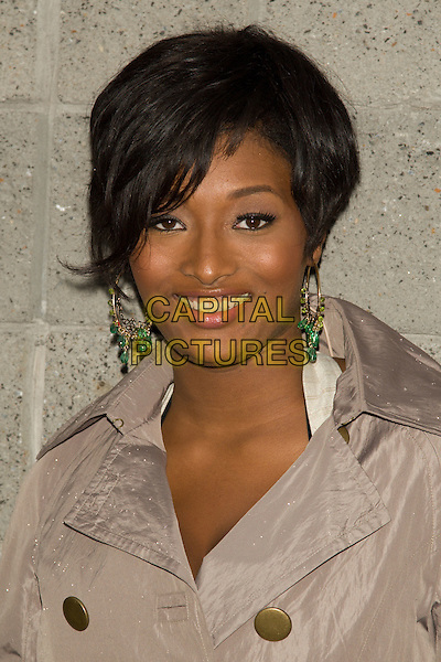 "TOCCARA JONES (presenter on BET & former contestant on America's Next Top Model).Premiere of ""Indiana Jones and the Kingdom of the Crystal Skull"" in Harlem.at the AMC Magic Johnson Theaters, Harlem, NY, USA..May 20th, 2008 .headshot portrait dangling gold earrings .CAP/LNC/TOM.©TOM/LNC/Capital Pictures."