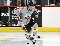 UNO's Rich Purslow brings the puck up ice. Denver beat Nebraska-Omaha 4-2 Saturday night at Qwest Center Omaha. (Photo by Michelle Bishop)