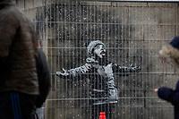 Pictured: A general view of the Banksy Graffiti in Taibach, Port Talbot, Wales, UK. Wednesday 19 December 2018<br /> Re: The artist Banksy has confirmed that a new graffiti piece that has appeared in south Wales is his.<br /> He used his verified Instagram account to announce: &quot;Season's greetings' - with a video of the artwork in Port Talbot.