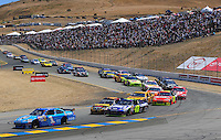 Jun. 21, 2009; Sonoma, CA, USA; NASCAR Sprint Cup Series driver Martin Truex Jr (1) leads a pack of cars during the SaveMart 350 at Infineon Raceway. Mandatory Credit: Mark J. Rebilas-