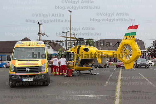 Ambulance personnel loads a rescue helicopter landed in a car park to help save a life in danger at Balatonlelle (about 140 km South-West of capital city Budapest), Hungary on July 18, 2015. ATTILA VOLGYI