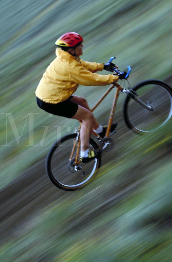 Woman mountain biking, blurred motion, Colorado. Susie Sutphin (MR 658). Colorado.