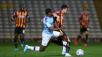 Nathaniel Ogbeta of Man City challenges Zeli Ismail of Bradford City for the ball during the The Leasing.com Trophy match between Bradford City and Manchester City U21 at the Utilita Energy Stadium, Bradford, England on 24 September 2019. Photo by Thomas Gadd.