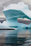This photo is on an iceberg with an opening or an arch, taken near the , Antarctic Peninsula, in the Lemaire Channel.