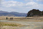 People walk to visit the ruins of Okawa Elementary School on March 11, 2016 in Ishinomaki, Miyagi Prefecture, Japan. Exactly 5 years earlier 74 out of the school's 108 students lost their lives as a result of the tsunami on March 11th, 2011. There are plans to rebuild the school but as yet this has not been fixed. The fate of the destroyed buildings is also expected to be decided soon with residents of the town divided as to whether they should be preserved as a memorial or removed. (Photo by Yusuke Nakanishi/AFLO)