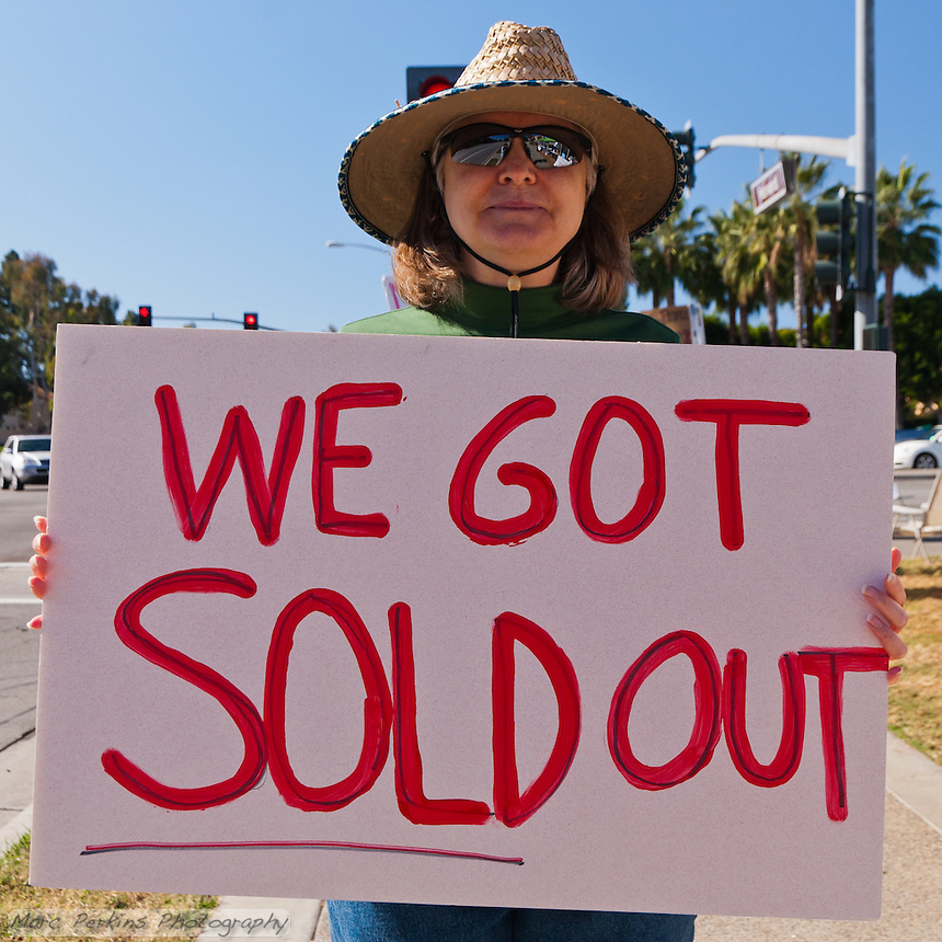 "Laurel holds a ""We got sold out"" sign at the Occupy Orange County, Irvine camp on November 5."