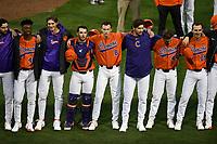 Members of the Clemson Tigers, including Keyshawn Askew, Logan Davidson, Byar Jawkins and James Parker, stand together as they sing the school's Alma Mater following in a game against the South Alabama Jaguars on Opening Day, Friday, February 15, 2019, at Doug Kingsmore Stadium in Clemson, South Carolina. Clemson won, 6-2. (Tom Priddy/Four Seam Images)