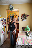 JAMAICA, Port Antonio. A local lady inside her kitchen.