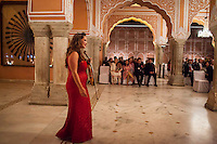 Australian violinist Niki Vasilakis re-enters the stage to receive her bouquet of flowers after playing a concert to a prominent audience, including the Jaipur Royal Family, and other VIPs during a recital at the OzFest Gala Dinner in the Jaipur City Palace, in Rajasthan, India on 10 January 2013. Photo by Suzanne Lee