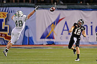 20 December 2011:  FIU quarterback Jake Medlock (12) watches as Marshall linebacker George Carpenter (48) attempts to break up his pass in the fourth quarter as the Marshall University Thundering Herd defeated the FIU Golden Panthers, 20-10, to win the Beef 'O'Brady's St. Petersburg Bowl at Tropicana Field in St. Petersburg, Florida.
