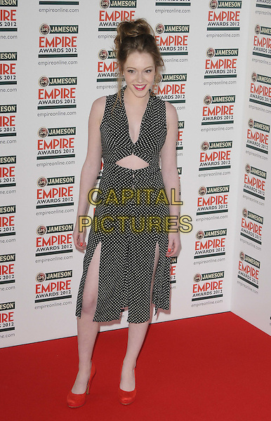 Charlotte Spencer.The Jameson Empire Film Awards 2012, Grosvenor House Hotel, Park Lane, London, England..March 25th, 2012.full length black dress  polka dot slit split cut out away red shoes .CAP/CAN.©Can Nguyen/Capital Pictures.