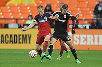 Washington, D.C.- March 29, 2014. Jeff Larentowicz of the Chicago Fire goes against Conor Doyle (30) of D.C. United. The Chicago Fire tied D.C. United 2-2 during a Major League Soccer Match for the 2014 season at RFK Stadium.