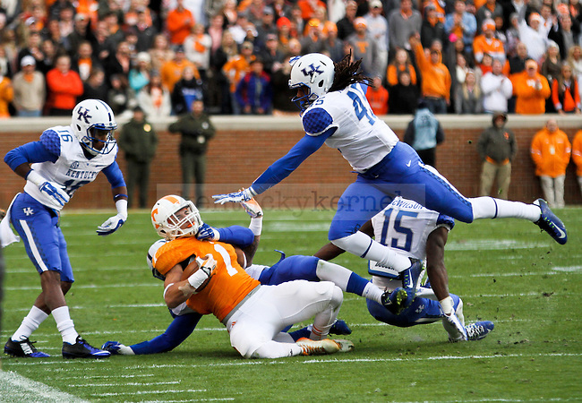 The UK defense makes a tackle on Tennessee running back Jalen Hurd during the first half of the University of Kentucky vs. University of Tennessee men's football game at Neyland Stadium in Lexington, Tn., on Friday, November 14, 2014 Photo by Jonathan Krueger | Staff